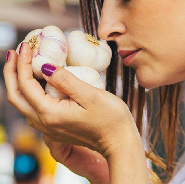 woman up close smelling garlic