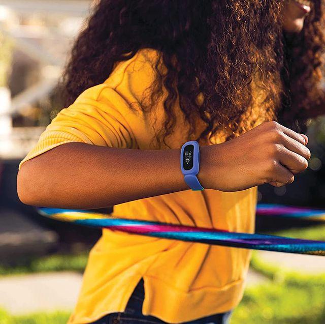 kid doing hula hoop with garmin fitness tracker on wrist