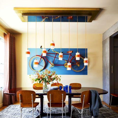 Room, Interior design, Floor, Bicycle wheel, Flooring, Furniture, Table, Interior design, Ceiling, Orange,