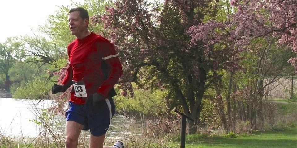 Steve Gathje runs a 5K in 2012n.