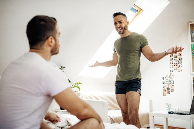 gay couple at home having and argument   lgbt break up