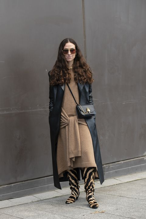 london, england   february 17 digital influencer erika boldrin wears a jw anderson dress and bag, black leather coat, bottega veneta sunglasses and khaite boots during london fashion week february 2020 on february 17, 2020 in london, england photo by kirstin sinclairgetty images