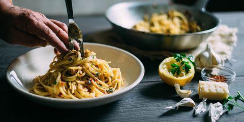 Man preparing pasta dish