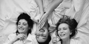 Black and white portrait of three women in the bed
