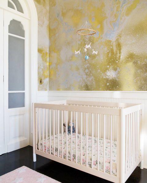 contemporary nursery with metallic wallpaper
