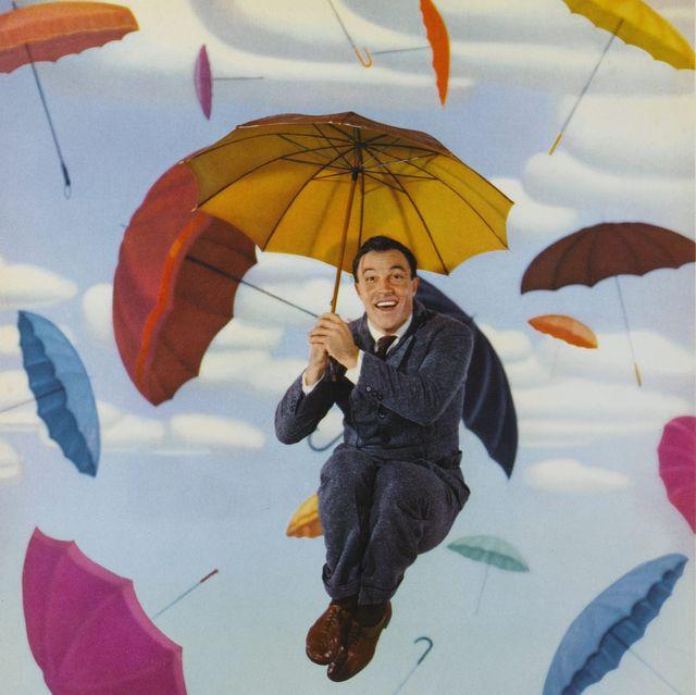 gene kelly cantando bajo la lluvia