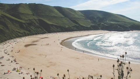 General view of the nudist beach of Torimbia, council of Llanes, Asturias, Spain
