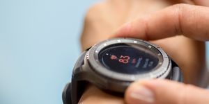 Generic design smartwatch. Touching screen. Pulse checking. heart rate monitor during jogging