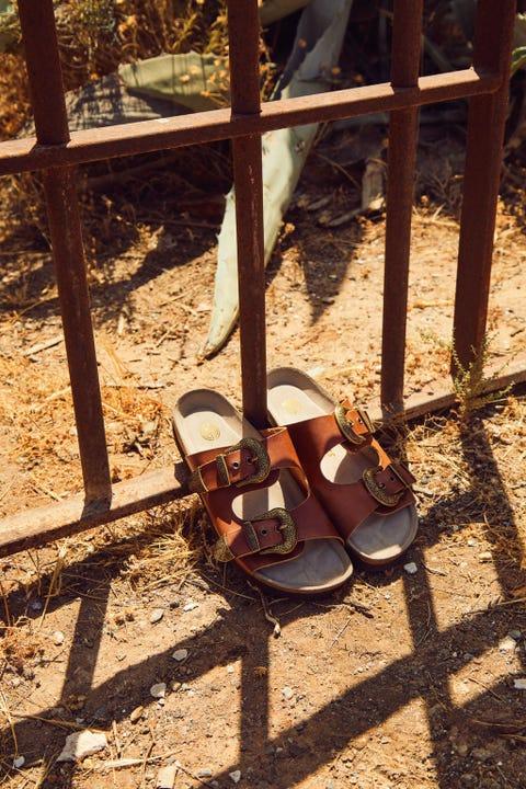 Shoe, Slipper, Sandal, Shadow, Iron, Foot, Tan, Flip-flops, Fence, Toe,