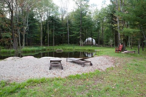 pond with seats in front of the geo dome