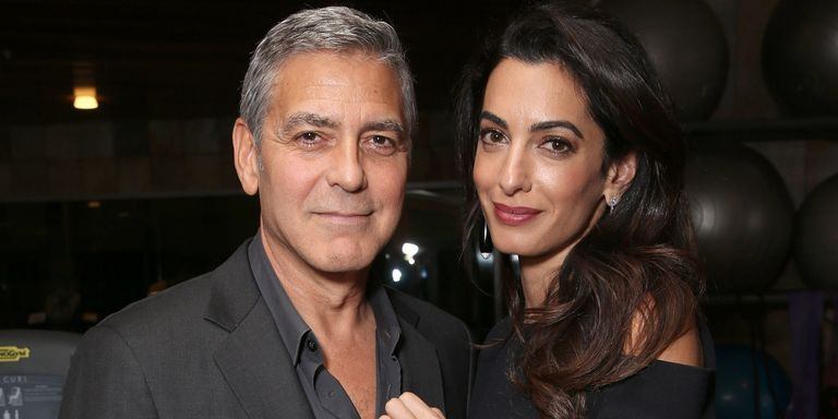 George and Amal Clooney at the Royal Wedding George-amal-royal-wedding-hbz-1526654775