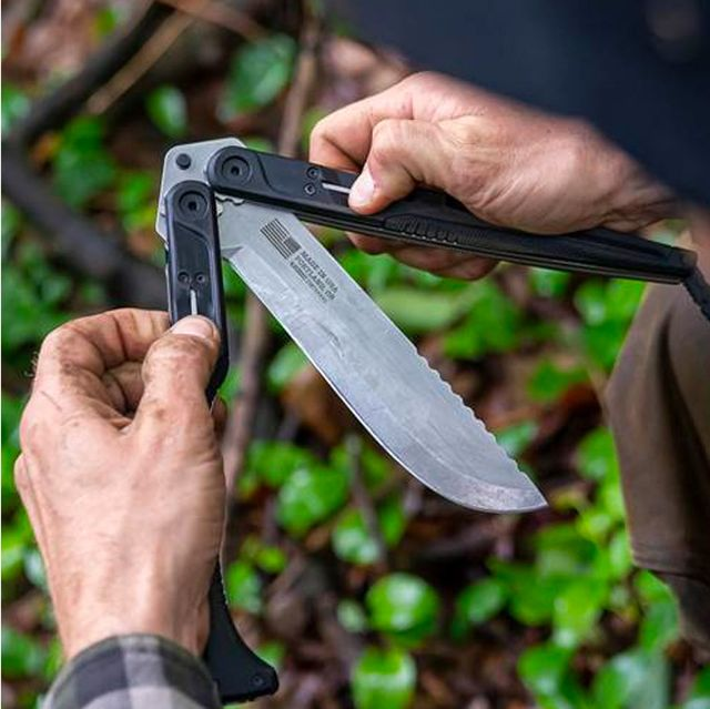 a man folding the handles of a large knife