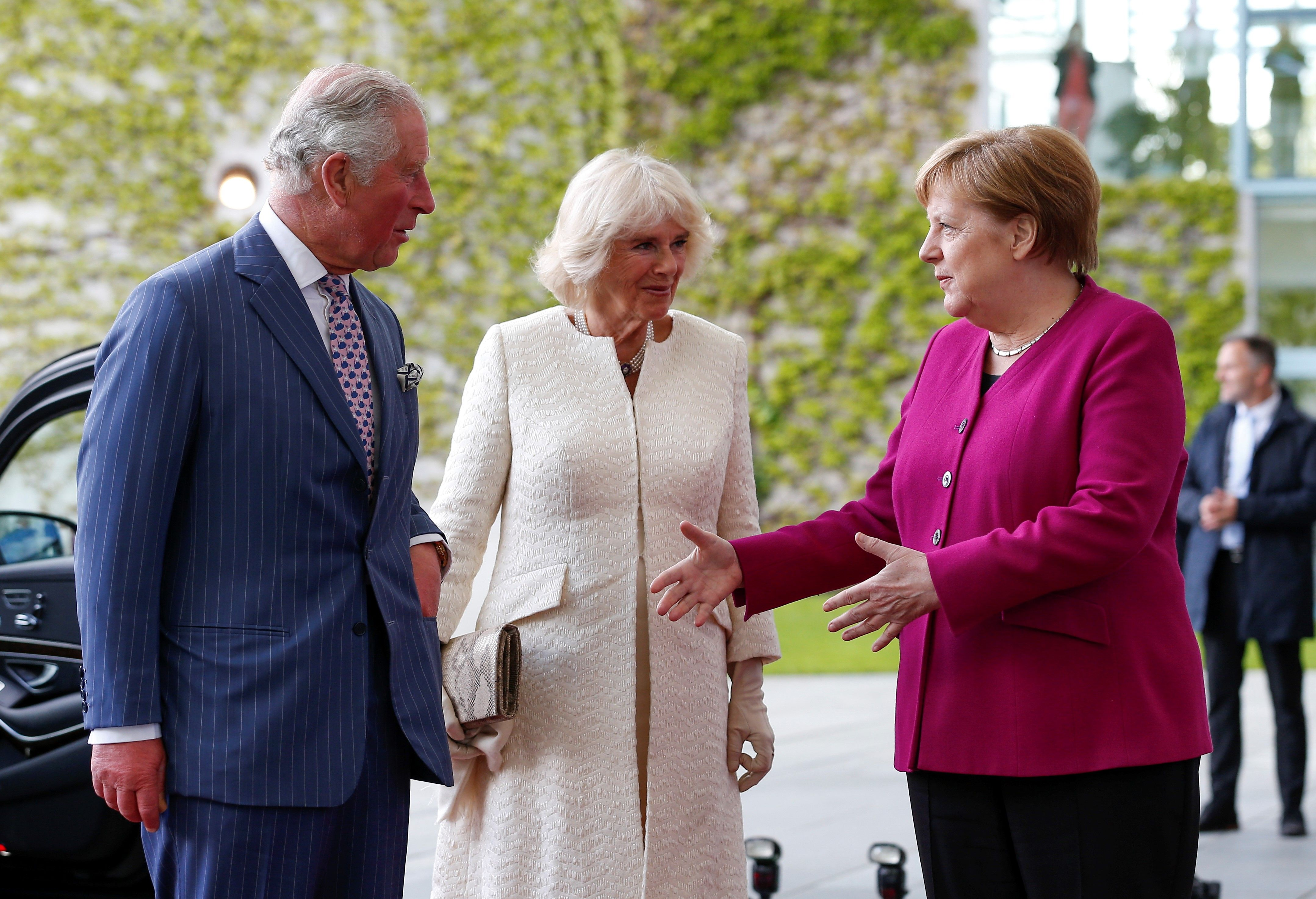 German Chancellor Angela Merkel welcomes Prince Charles and Duchess of Cornwall Camilla to Germany. While in the country, the royal couple will visit Berlin, Munich, and Leipzig.