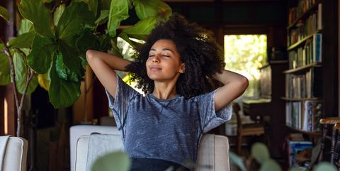 Young woman spending a relaxing day in her beautiful home
