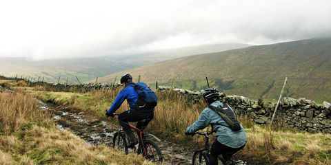 Man and woman riding trail in Irish countryside