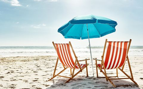 two beach chairs and an umbrella