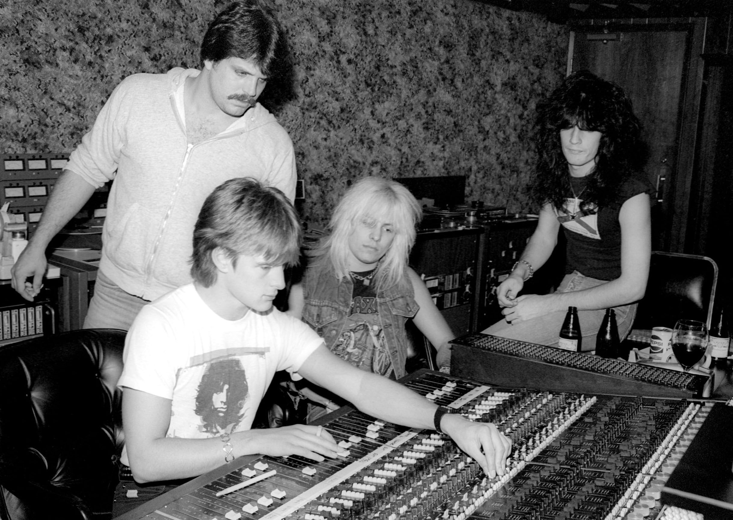 Vince Neil (C) and Tommy Lee (R) of  Mötley Crüe recording at Cherokee Recording Studios in Los Angeles, California in 1981.