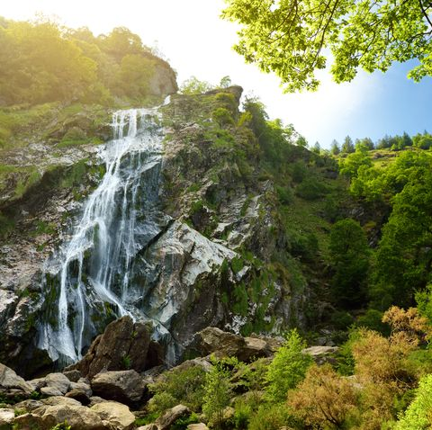 majestic water cascade of powerscourt waterfall, the highest waterfall in ireland famous tourist atractions in co wicklow, ireland