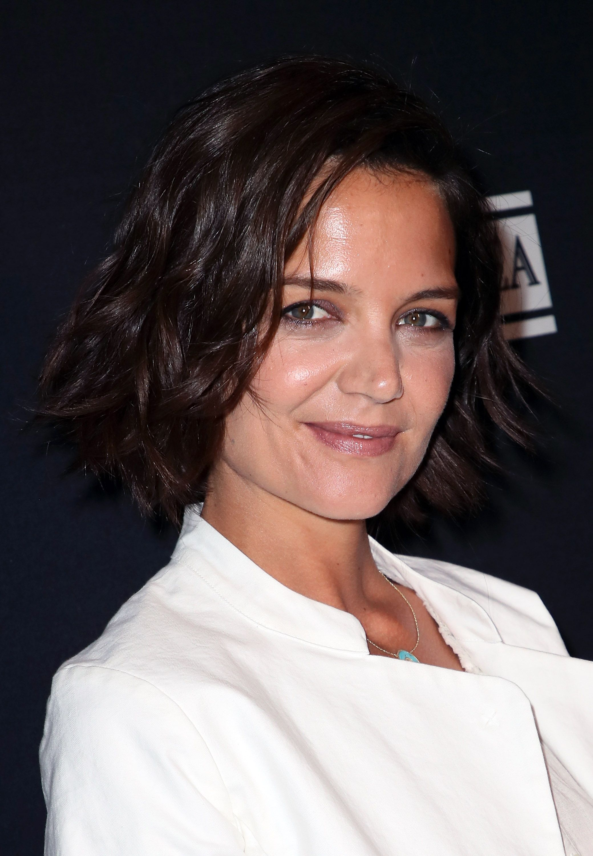 Katie Holmes Wears the Most Perfect Transitional Spring Outerwear—an Aritzia Trench Coat