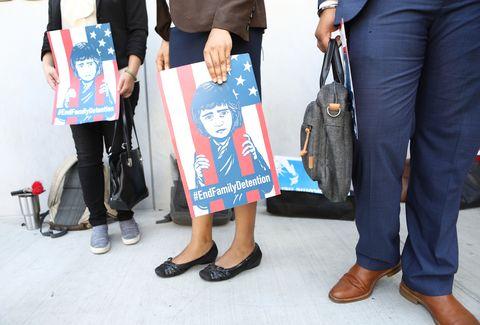 Fashion, Footwear, Street fashion, Leg, Jeans, Standing, Shoe, Denim, T-shirt, Fashion accessory,