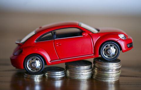 Volkswagen Beetle on coin stacks