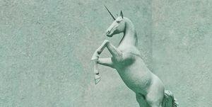 Unicorn stone statue rearing up on hind legs