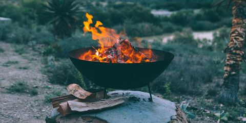 Firewood Burning In Fire Pit - 10 Fire Pits That Make Fall Evenings Extra Magical