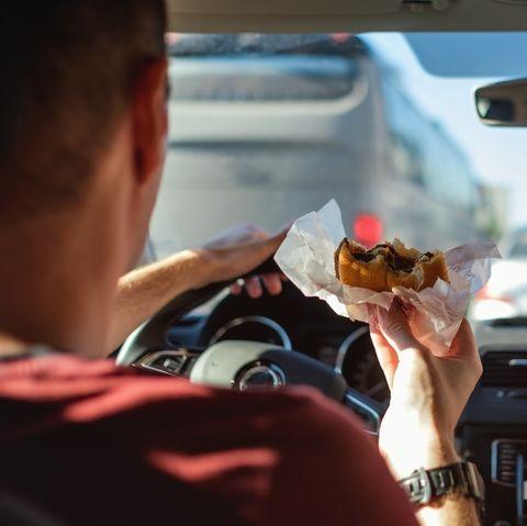 Windshield, Automotive mirror, Driving, Rear-view mirror, Vehicle, Hand, Steering wheel, Car, Automotive window part, Food,