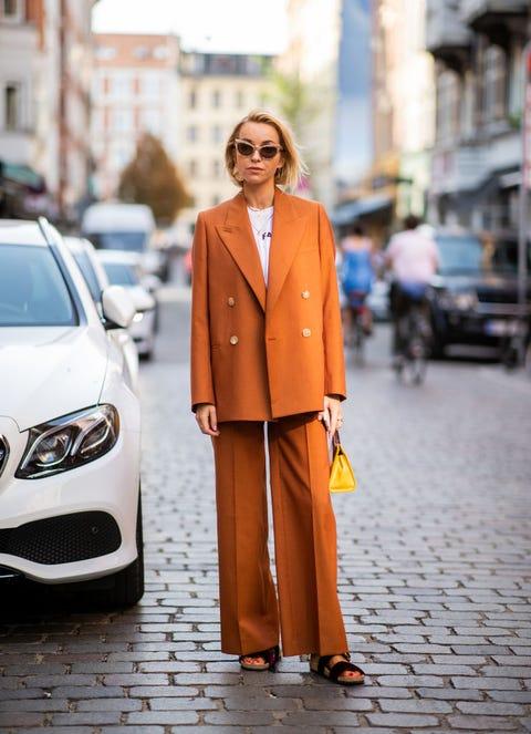 Street fashion, Orange, Photograph, Clothing, Suit, Fashion, Yellow, Automotive design, Formal wear, Snapshot,