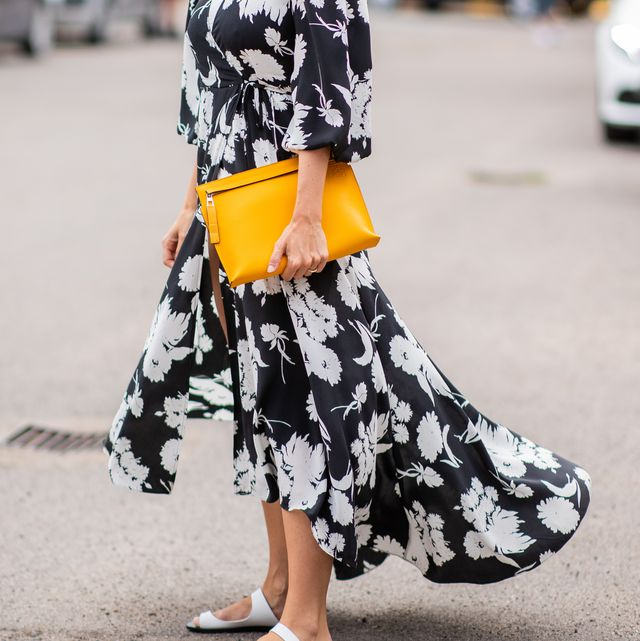 copenhagen, denmark   august 08 a guest wearing dress with floral print, yellow loewe clutch is seen outside cecilie bahnsen during the copenhagen fashion week springsummer 2019 on august 8, 2018 in copenhagen, denmark photo by christian vieriggetty images