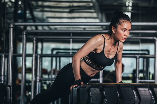 one woman, beautiful chinese woman training alone in gym