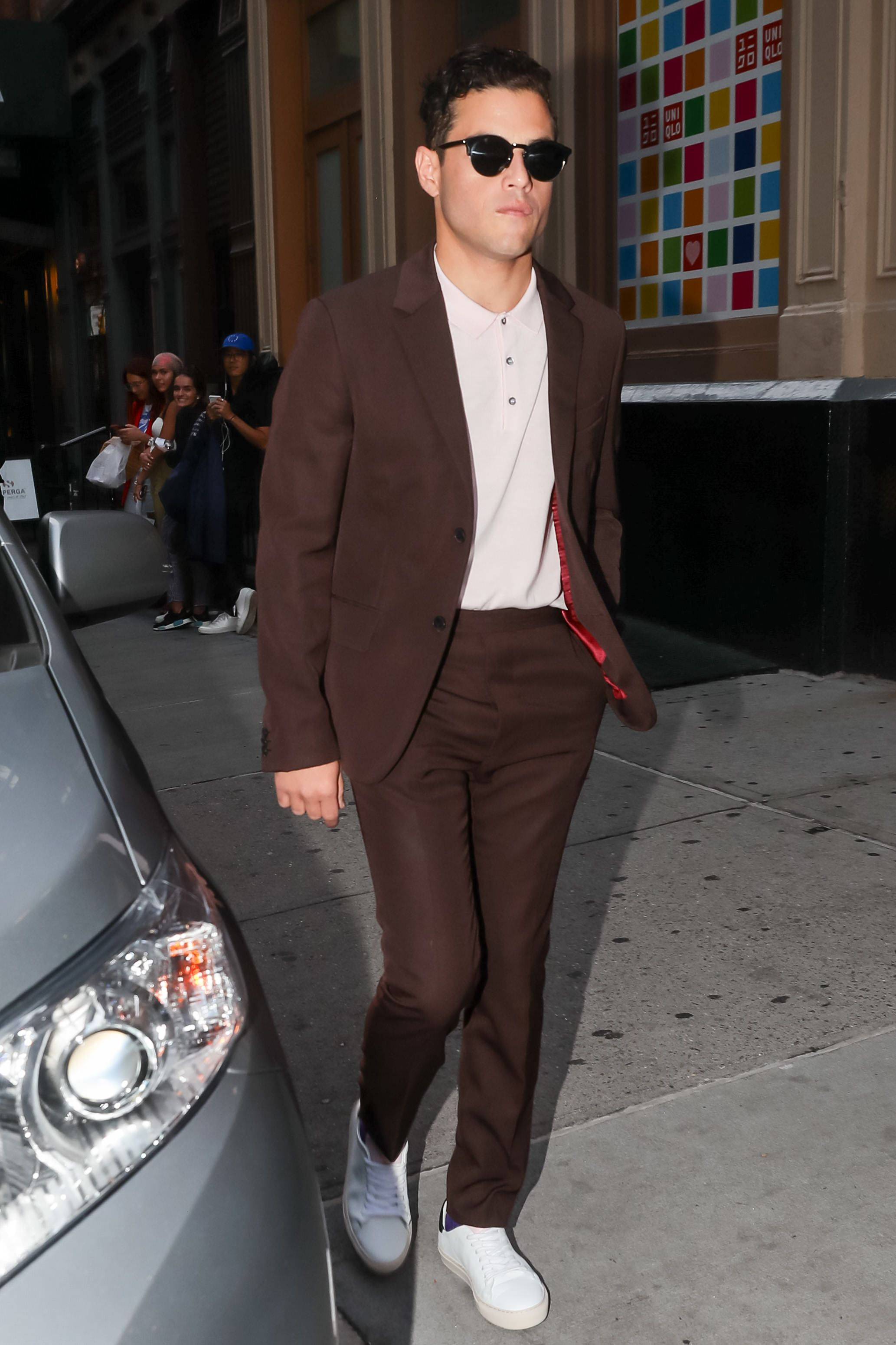 Rami Malek Another stellar example of opting for a polo with a suit. Plus, this is exactly the kind of combination you can pull off with a pair of sneakers.