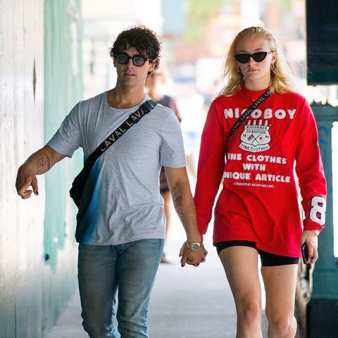 Clothing, T-shirt, Street fashion, Eyewear, Fashion, Cool, Shoulder, Sleeve, Sunglasses, Footwear,