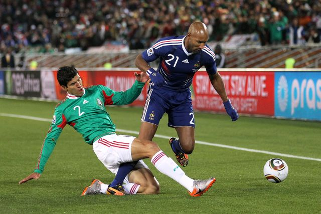 polokwane, south africa   june 17 francisco rodriguez of mexico tackles nicolas anelka of france during the 2010 fifa world cup south africa group a match between france and mexico at the peter mokaba stadium on june 17, 2010 in polokwane, south africa  photo by streeter leckagetty images