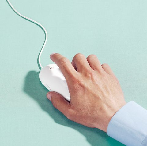 Man using computer mouse, close-up of hand