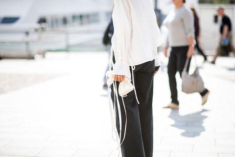 White, Street fashion, Clothing, Fashion, Standing, Snapshot, Leg, Jeans, Waist, Blazer,