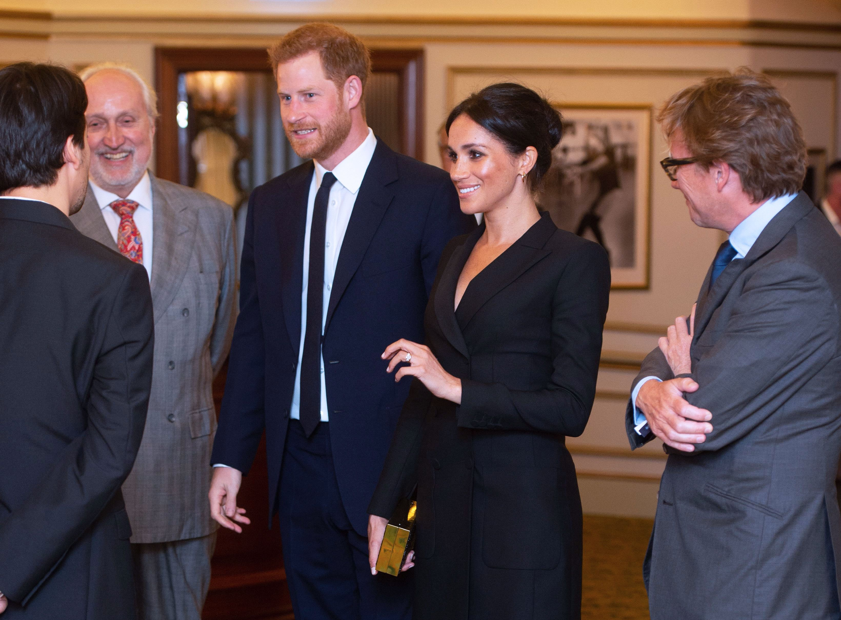 5bcf80eef01 Meghan Markle's 'Hamilton' Tuxedo Dress Killed an Old Rumor About Royal  Protocol