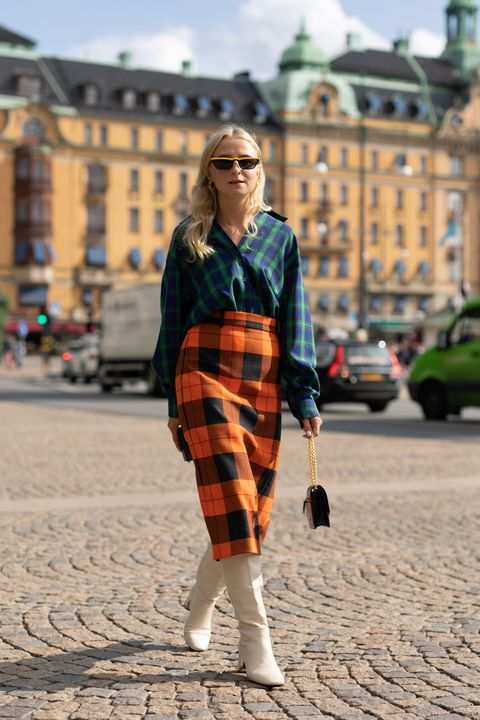 stockholm, sweden   august 29  a guest is seen on the street during fashion week stockholm ss19 wearing a navygreen plaid shirt with orange plaid skirt on august 29, 2018 in stockholm, sweden  photo by matthew sperzelgetty images