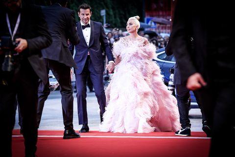 Dress, Red carpet, Facial expression, Gown, Carpet, Event, Wedding dress, Fashion, Ceremony, Premiere,