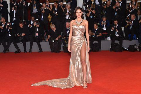 Red carpet, Carpet, Dress, Flooring, Fashion model, Gown, Premiere, Fashion, Event, Haute couture,