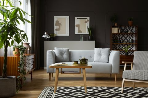 Living room, Furniture, Room, Interior design, Floor, Couch, Table, Coffee table, Wall, Brown,