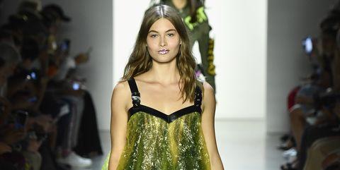 Fashion model, Fashion show, Fashion, Runway, Clothing, Shoulder, Yellow, Fashion design, Footwear, Joint,