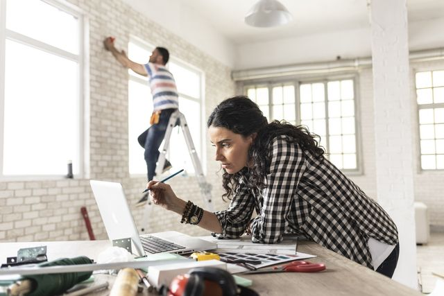 woman making home improvement and using laptop, redecorating