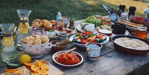 food for picnic day in the countryside various foods on an old, rustic, wooden table