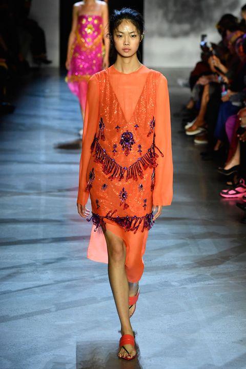Fashion model, Fashion show, Runway, Fashion, Clothing, Orange, Shoulder, Fashion design, Joint, Event,