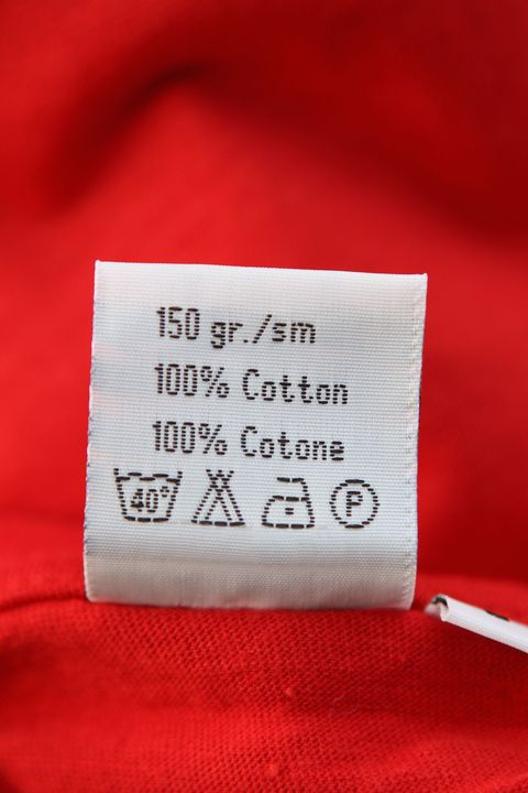 washing label on red cloth, close up