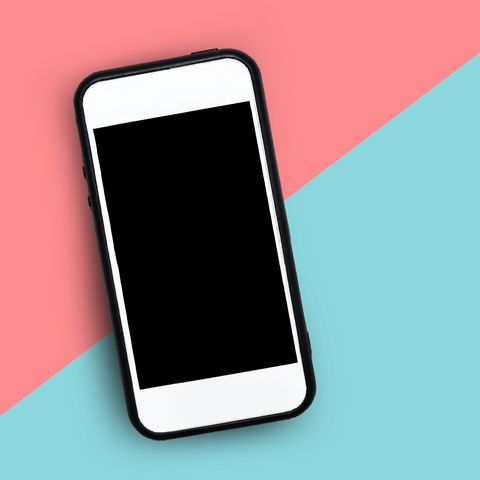 Close-Up Of Smart Phone Over Colored Background