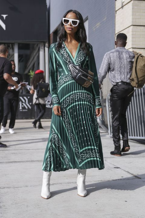 new york, ny   september 11 janelle lloyd is seen wearing a green sandro dress and white boots on the street during new york fashion week on september 11, 2018 in new york city  photo by achim aaron hardinggetty images