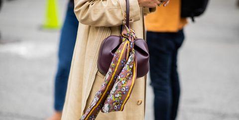 Street fashion, Yellow, Fashion, Outerwear, Headgear, Textile, Fashion accessory, Style,