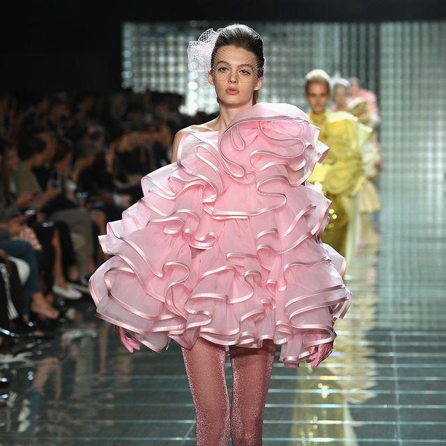 Fashion model, Fashion, Fashion show, Runway, Pink, Haute couture, Clothing, Fashion design, Shoulder, Dress,